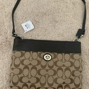 Never used before coach crossbody bag!
